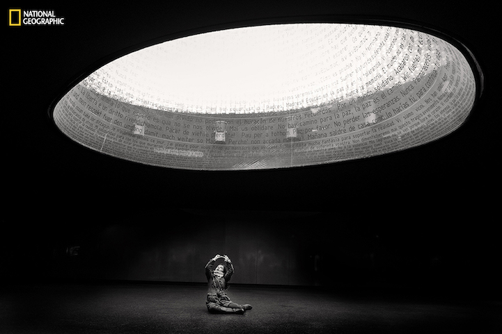 A little girl plays in the monument to the victims of the attack of 11M in Atocha train station in Madrid