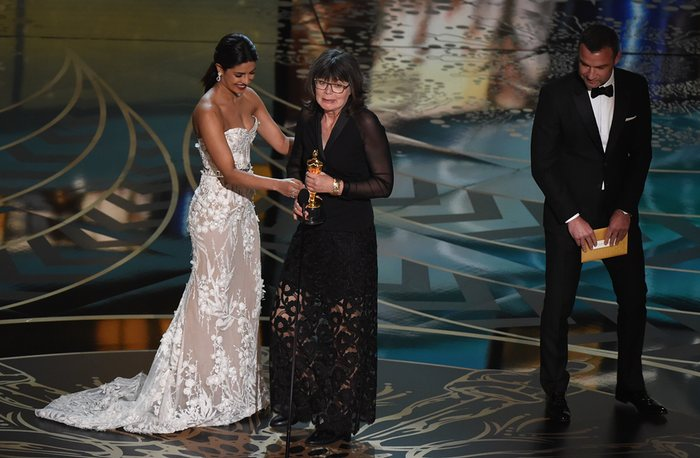 Liev Schreiber and Priyanka Chopra present the award for best achievement in film editing to Margaret Sixel, for Mad Max: Fury Road Photograph: Mark Ralston/AFP/Getty Images
